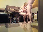 Hubby and wife fucking each other in the lounge on the sofa