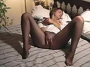 Wife in tights massaging her mature vag in bed