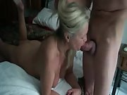 Watch a mature grandma giving head to her guy